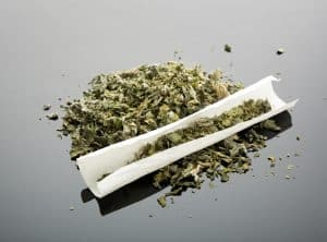 Mary Jane when state-legal - Fairfax criminal lawyer addresses side risks - Photo of marijuana and rolling paper