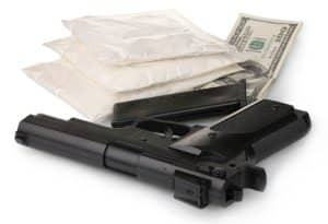 Robbery of stolen contraband is still robbery says Fairfax criminal lawyer - Image of gun and cocaine and money