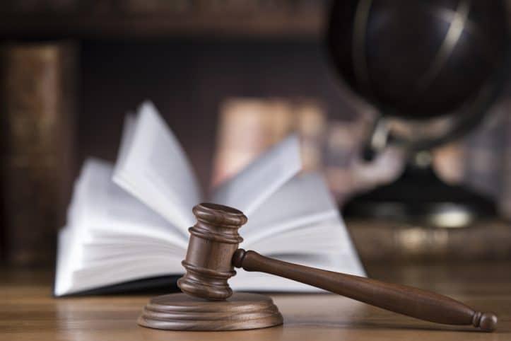 Defensive attacks- Photo of lawbook and judicial mallet