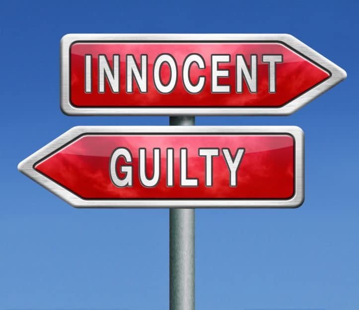 Trial success- Photo of innocent and guilty sign