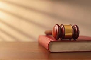 Virginia statutory interpretation for criminal defense - Image of gavel and lawbook