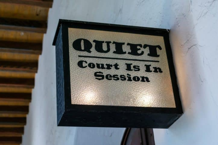 Rule on witness violations- Photo of sign saying quiet- court in session