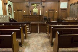 Practice Areas - Photograph of courtroom with wooden benches