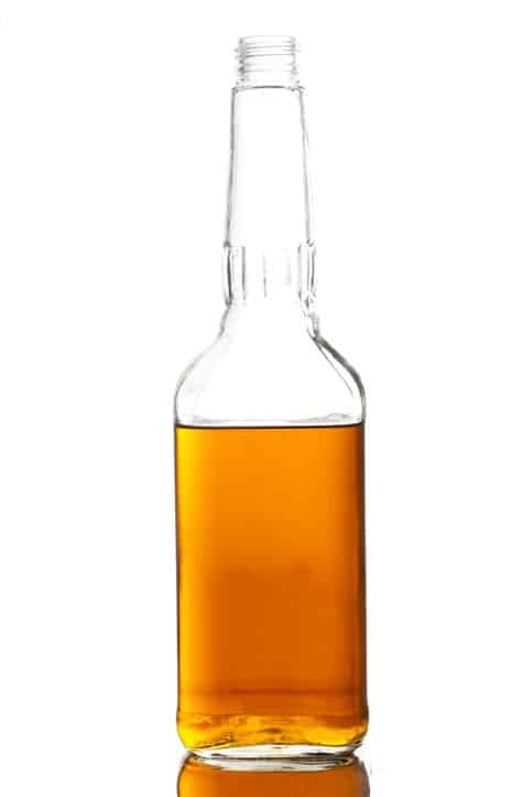 Drinking and driving- Partially full liquor bottle