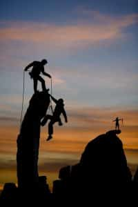 Welcoming Virginia DUI court- Fairfax criminal lawyer on overcoming fears- Photo of rockclimbing teamwork