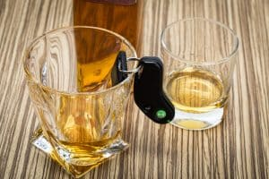 Breathalyzer challenges in VA DUI cases- View of Fairfax criminal lawyer- Photo of liquor glass and keys